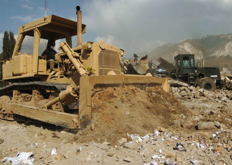 2005:    On Nov. 2, Seabees assigned to Naval Mobile Construction Battalion (NMCB) 74 and a Pakistani engineering company worked together to clear debris caused by the earthquake in Muzaffarabad, Pakistan. The United States was participating in a multi-national assistance and support effort led by the Pakistani Government to bring aid to the victims of the devastating earthquake that struck the region on 8 October 2005. (Photo courtesy of U.S. Naval Seabee Museum)