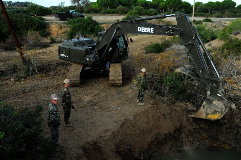 2009:    Seabees from Naval Mobile Construction Battalion (NMCB) 3 operated an excavator to remove trash and brush from a natural spring at Naval Station Rota Spain. NMCB-3 restored the spring as part of an environmental rejuvenation project, which was requested by the Spanish Navy. (Courtesy of U.S. Navy Seabee Museum)