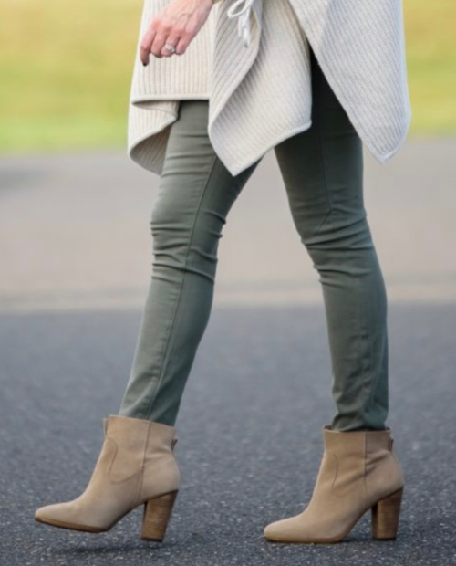 This look isn't the best, because the jeans are tucked in like tights, and the booties are a different color than the pant, which creates a chopped up unsophisticated look.