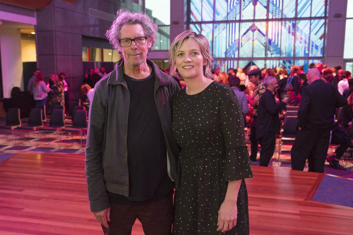 Winner of the 2017 New Zealand Photobook Award Allan McDonald with Libby Jeffery, co-founder and marketing manager of award sponsor Momento Pro, at the opening of the Photobook/NZ Festival, Te Papa, 9 March, 2018.