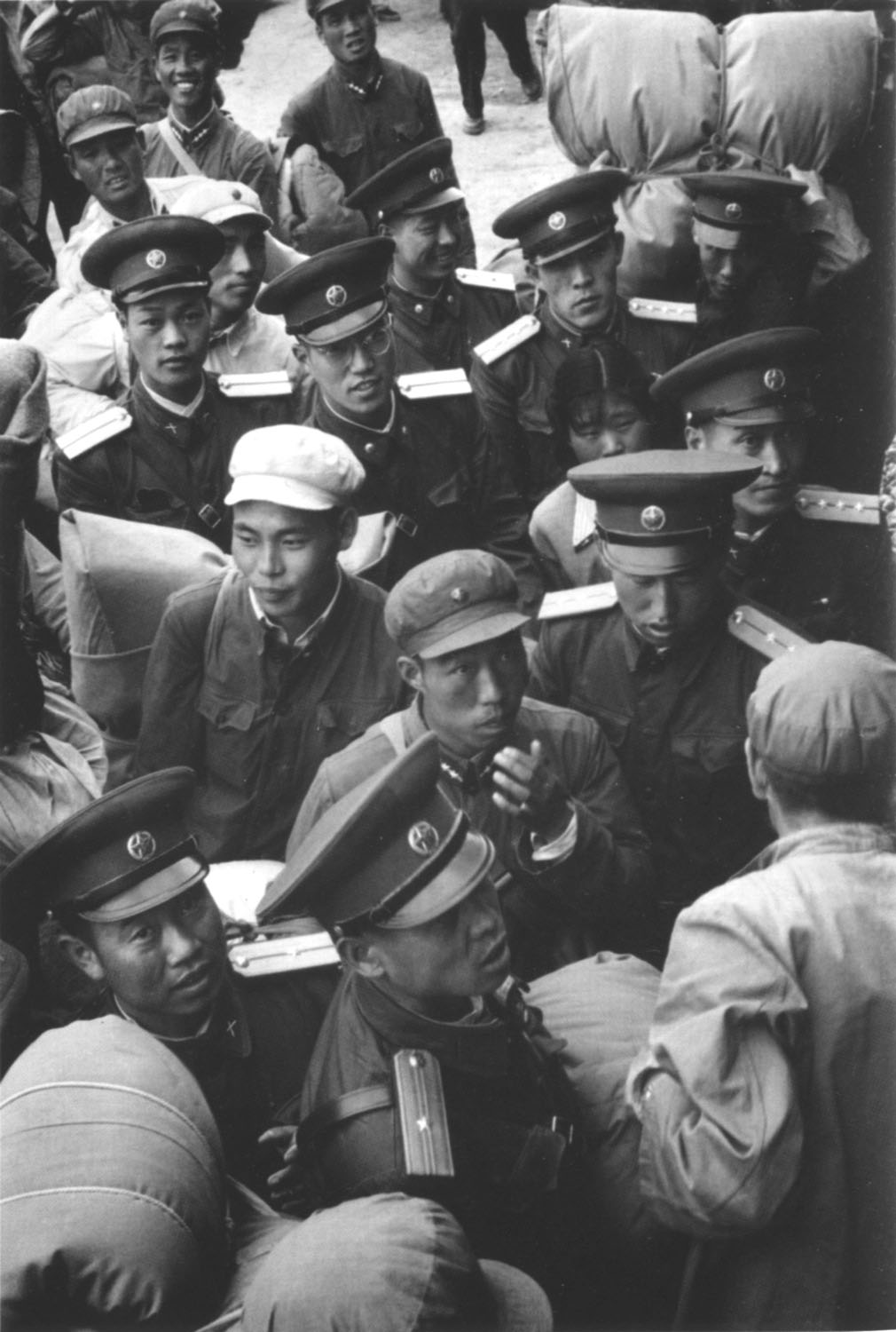 Tom Hutchins.  Soldiers and peasants going west at Wu Wei, far west Kansu (Gansu) Province, China , 3 July 1956. Published in  Tom Hutchins - Seen in China , Turner Photobooks and PhotoForum, 2016.