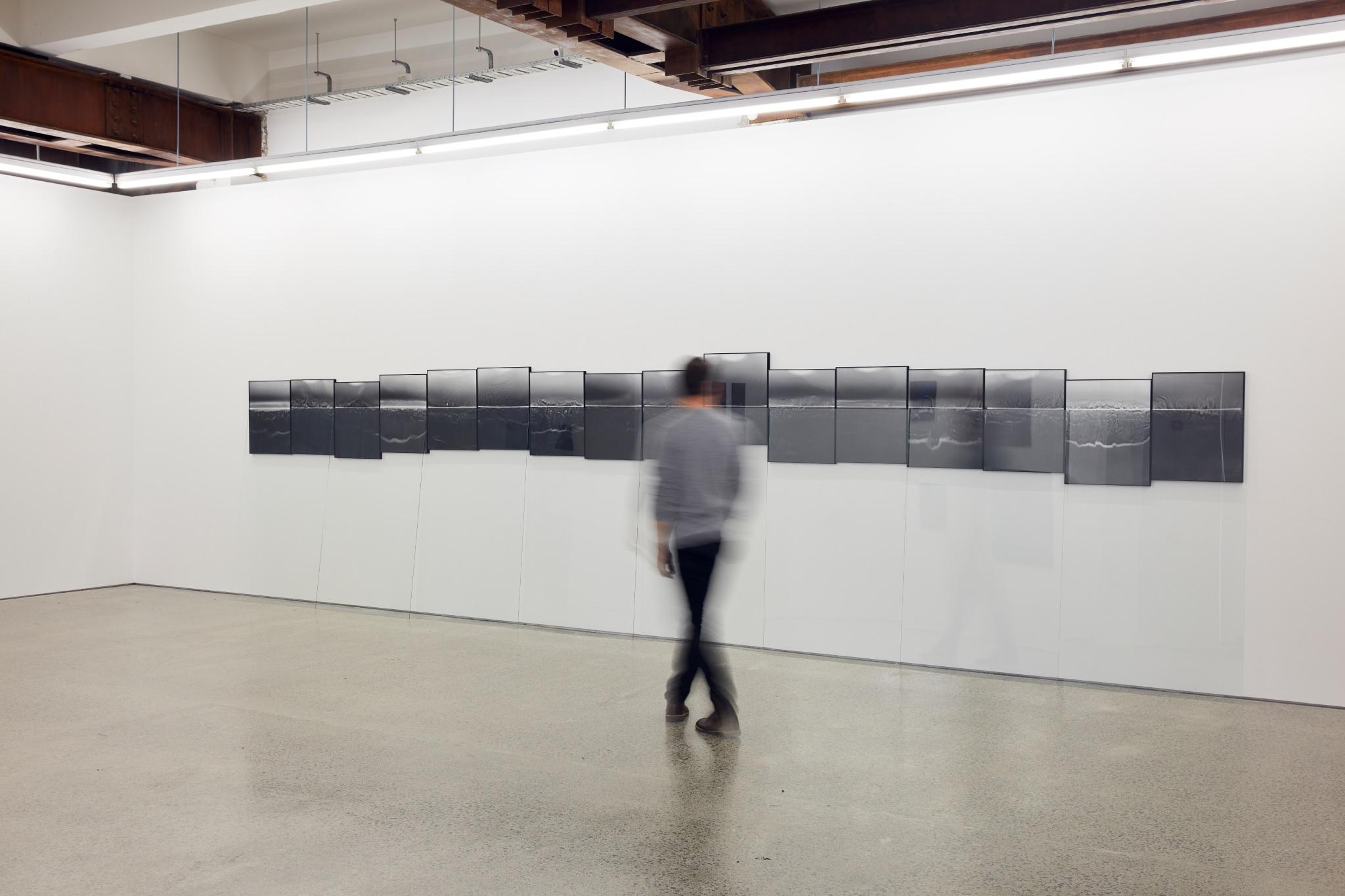 Open Surface (Holon),  2018  Silver gelatin prints, museum glass in artist frames  7300mm x 600mm