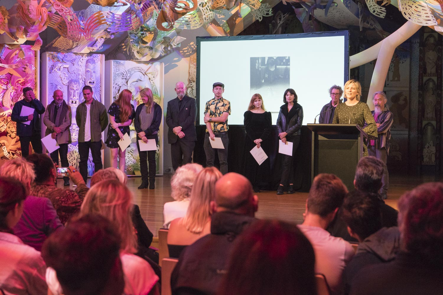 Libby Jeffery from sponsor Momento Pro announcing the winner of the 2017 New Zealand Photobook Award at the opening of the Photobook/NZ Festival, Te Papa, 9 March, 2018.