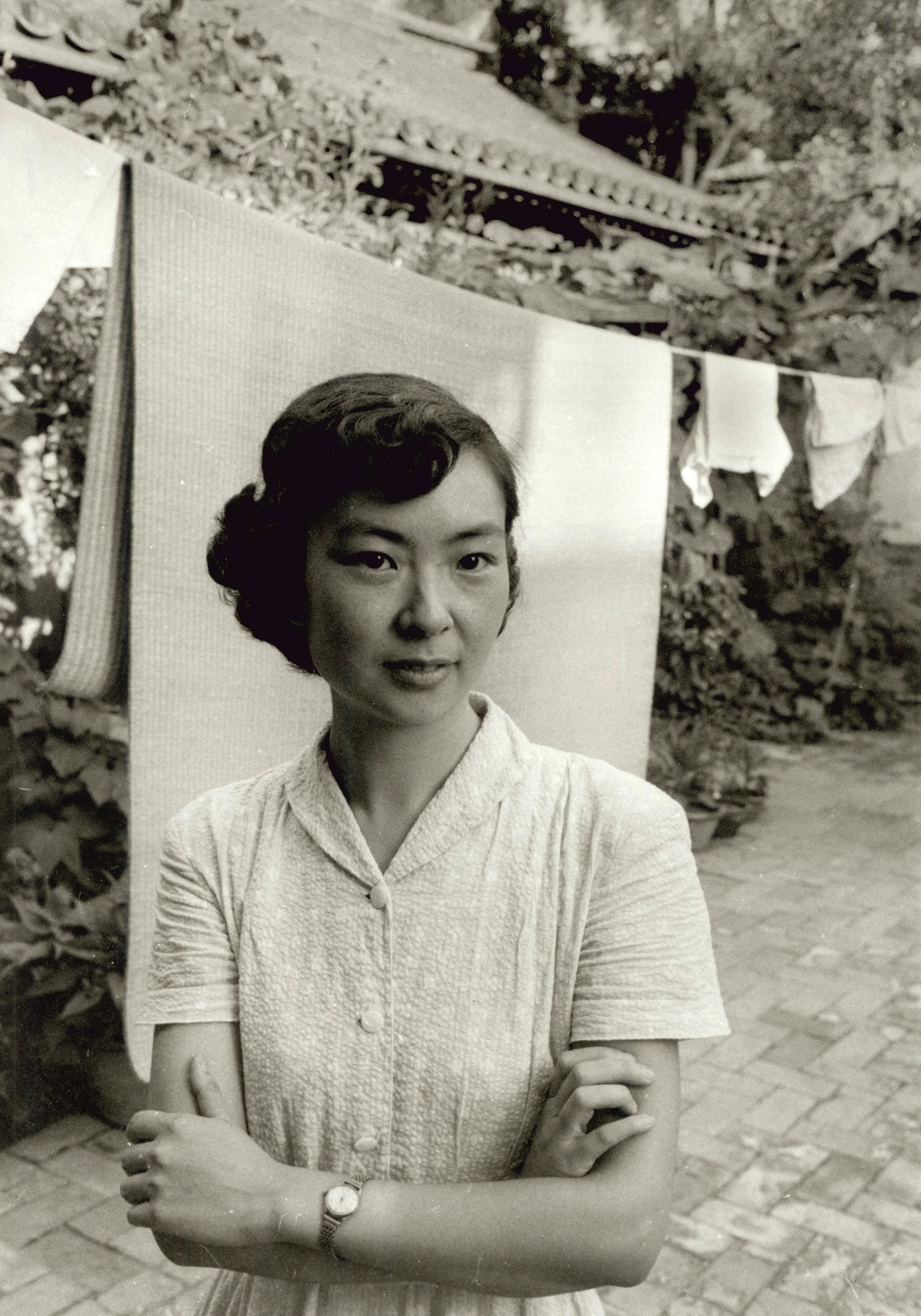 Wife of a music composer at their home in Peking. China, 1956. (RDH C017-24)