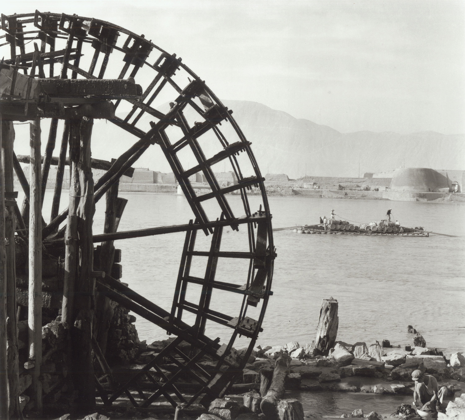 A waterwheel on the Yellow River supplies local irrigation needs at Lanchow. China, July 1956. (RDH R24-05)