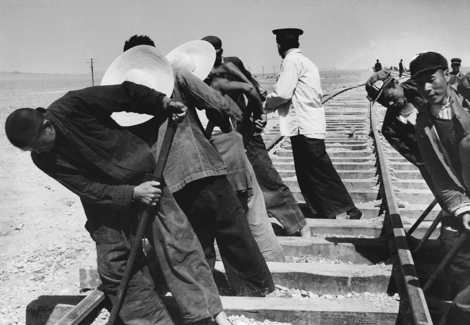 Men working on the Sinkiang railway in the Gobi Desert. China, July 1956.  (RDH C081-25)