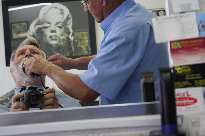 Self-portrait. John B. Turner and Ron Trenary, The Peninsula Barber, Harbour View Road, 18 April 2005. (JBT004106)