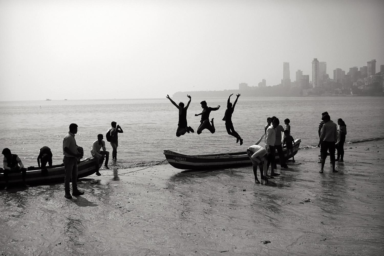 Julian Ward:  Three Boys Jumping. Mumbai, India  2018