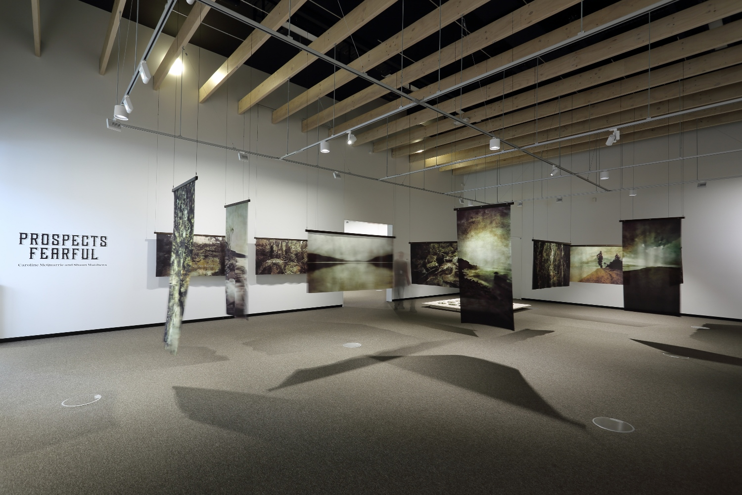 Installation view of the photographs in  Prospects Fearful  by Caroline McQuarrie and Shaun Matthews. (Photograph by John-Paul Pochin).