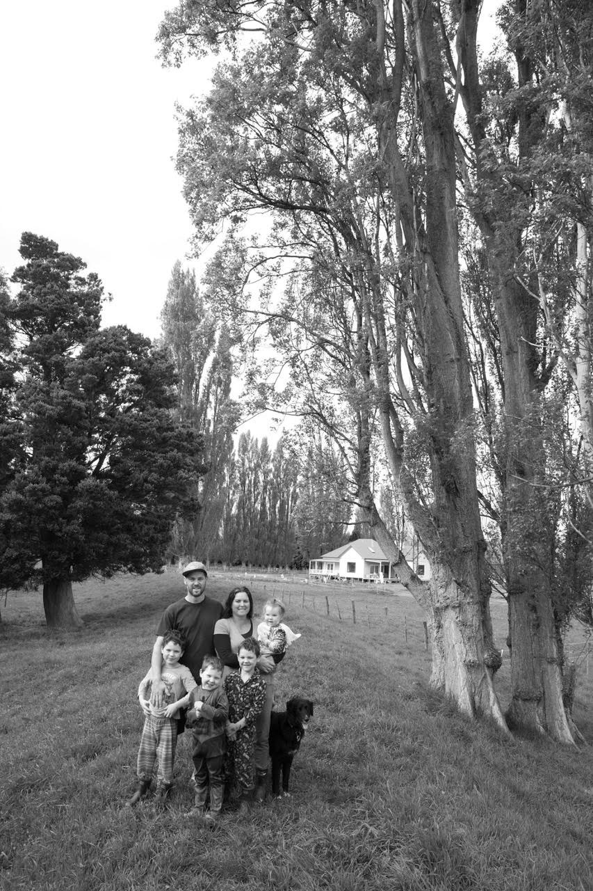 Anna, Don, Alby, Charlie, Rupert, Daphne, Baxter & Mack   Photographer, Camera Operator, Primary School Boys, Kindy Kid, Collie-Retriever X, Black Lab… somewhere chasing rabbits  October 2107  This place is the only place in the world we could live and build our forever home, overlooked by the poplars my grandfather planted, on land our children's ancestors lived and worked and played.  A place of big skies, of hills and mountains, of rivers and of family. Masterton is home.  – Anna