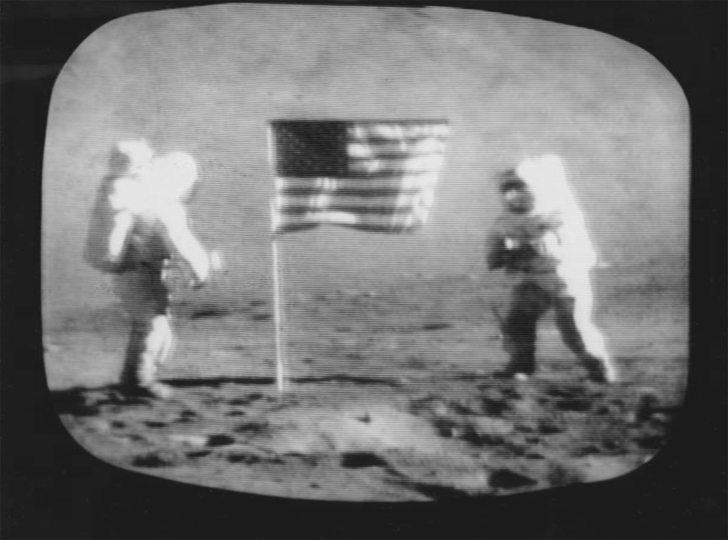 Associated Wire Press Photo (USA), After unfurling the American flag, the astronauts photographed each other. Cernan (right) got set to snap a picture of Schmitt. 12 December 1972. Collection of Geoffrey Batchen, Wellington.