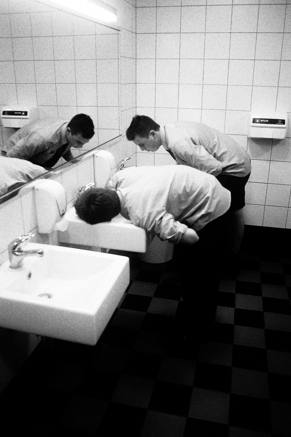 Students drinking from the tap in the CPAC bathroom, 2016