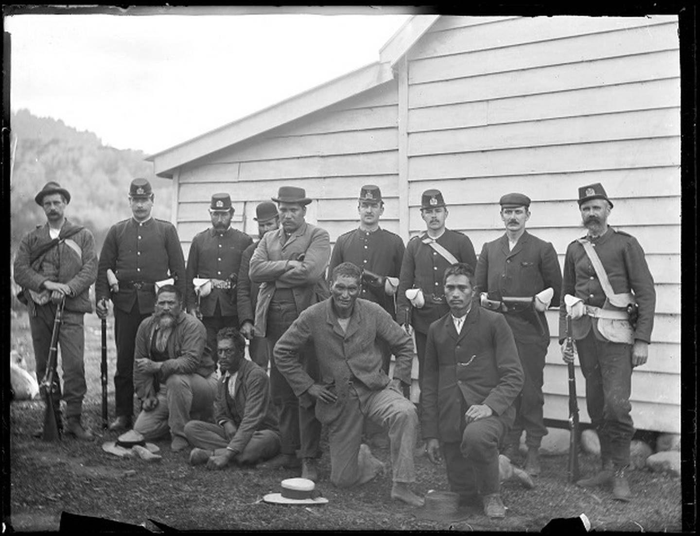 Māori dog-tax resisters, including leader Hone Toia (centre, standing), following their surrender at Waima in Northland in 1898. Photo / Charlie Dawes, Auckland Libraries