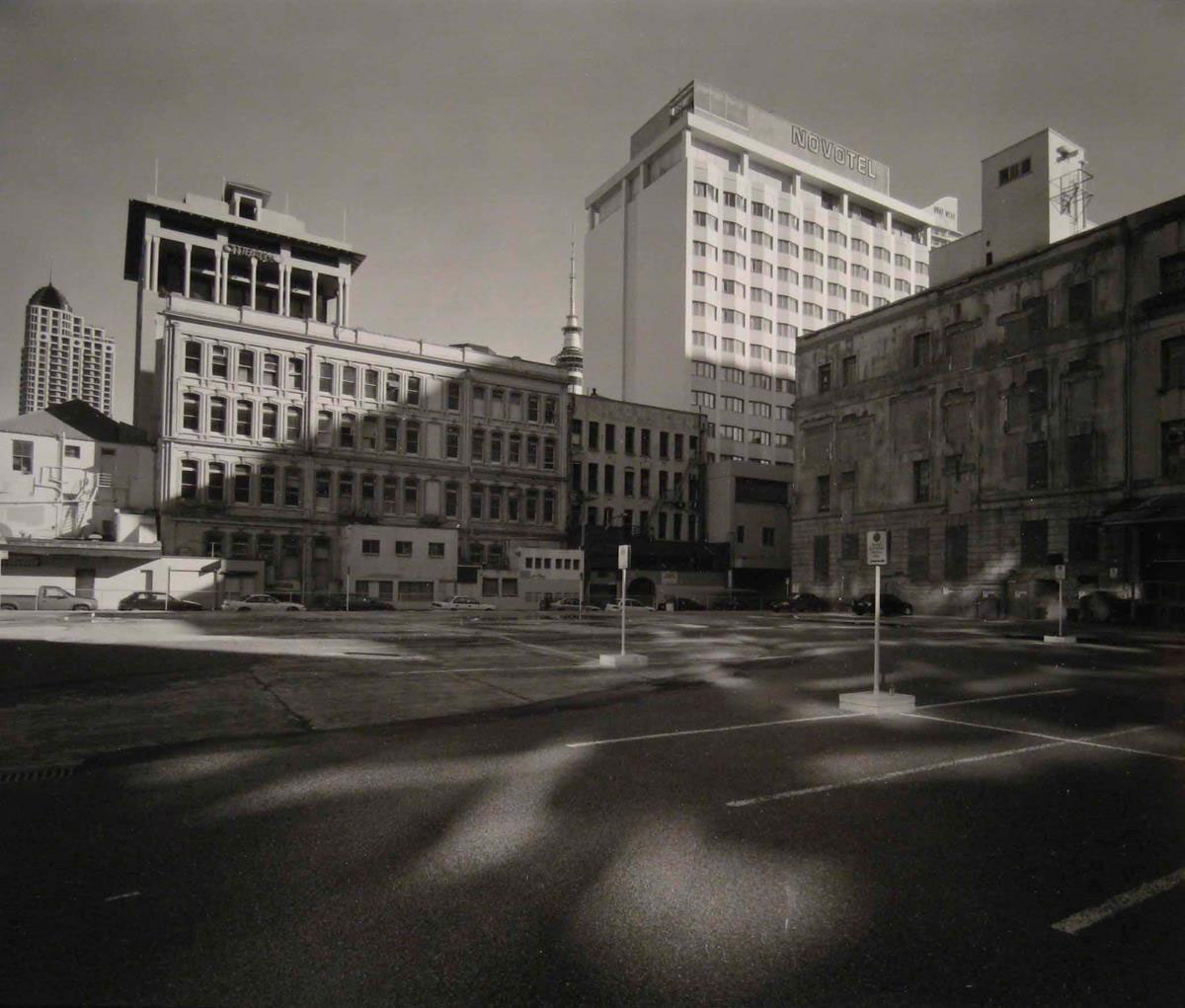 Haruhiko Sameshima,  Temporary carpark, behind central post office, corner Tyler and Commerce Streets, prior to Britomart Transport Centre Development, CBD.  From the series,  Ten Views of Sky Tower,  2001