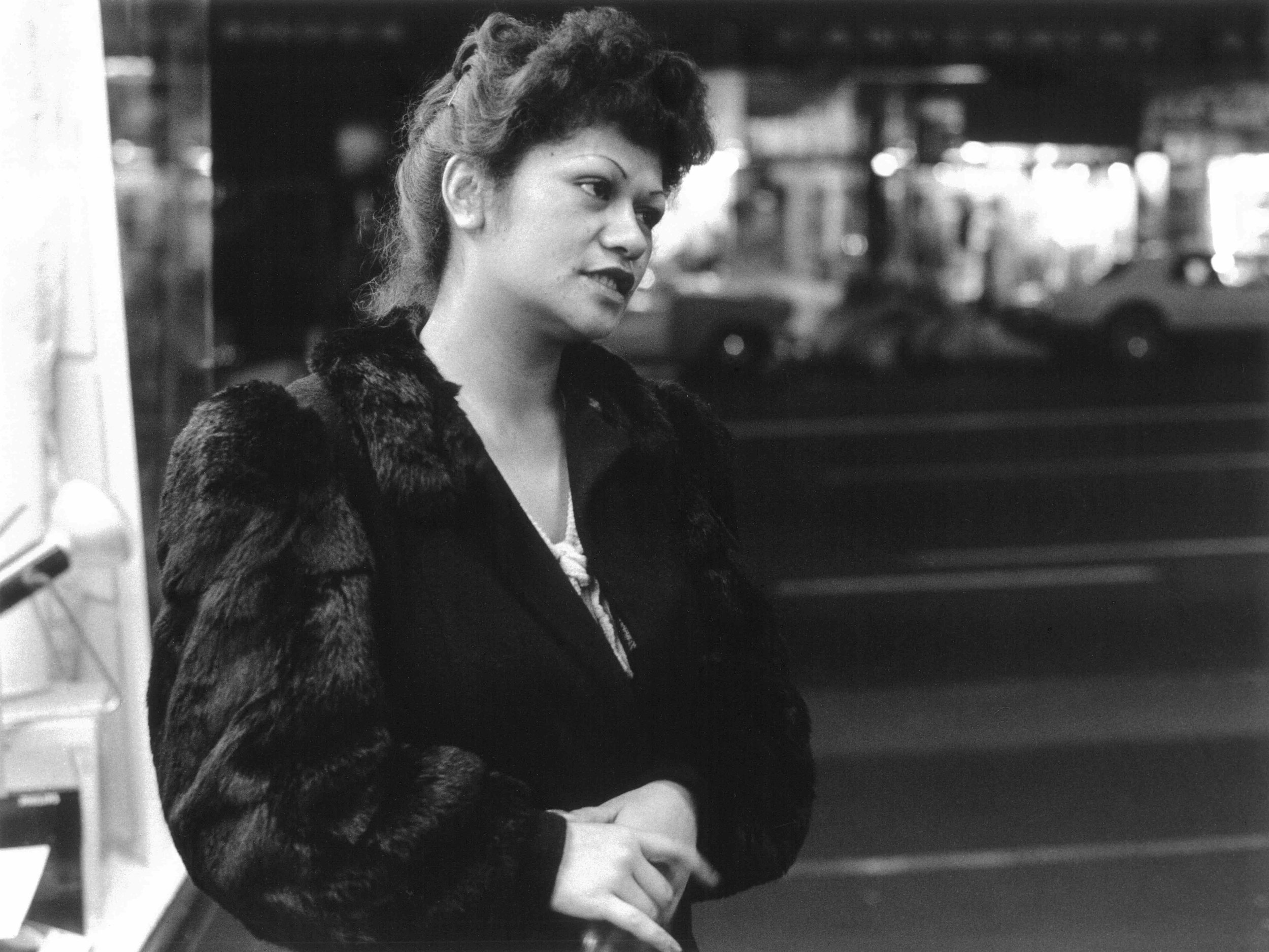 Murray Cammick,  Young woman in fur ,  Queen St,  1976