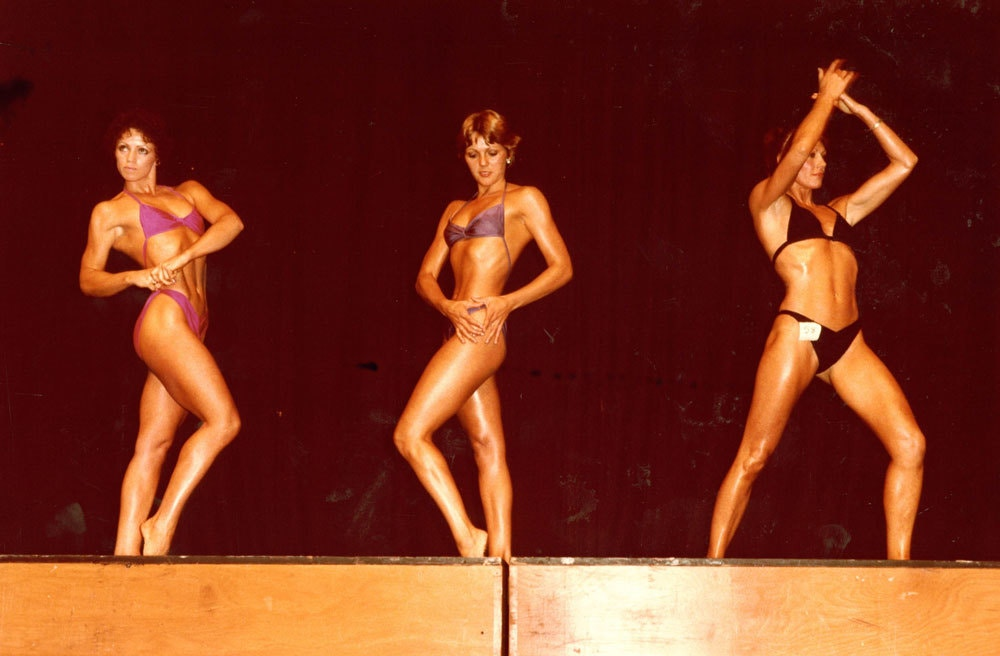 Fiona Clark   Pan Pacific Womens' Body Building Championship posing, Auckland 1981  1981. Cropped image. Courtesy the artist and Michael Lett