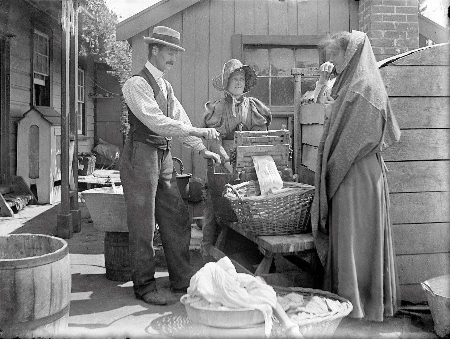 Man pretending to help with the laundry (look at his hands), New Zealand circa 1907-1916. Lemuel Lyes Collection