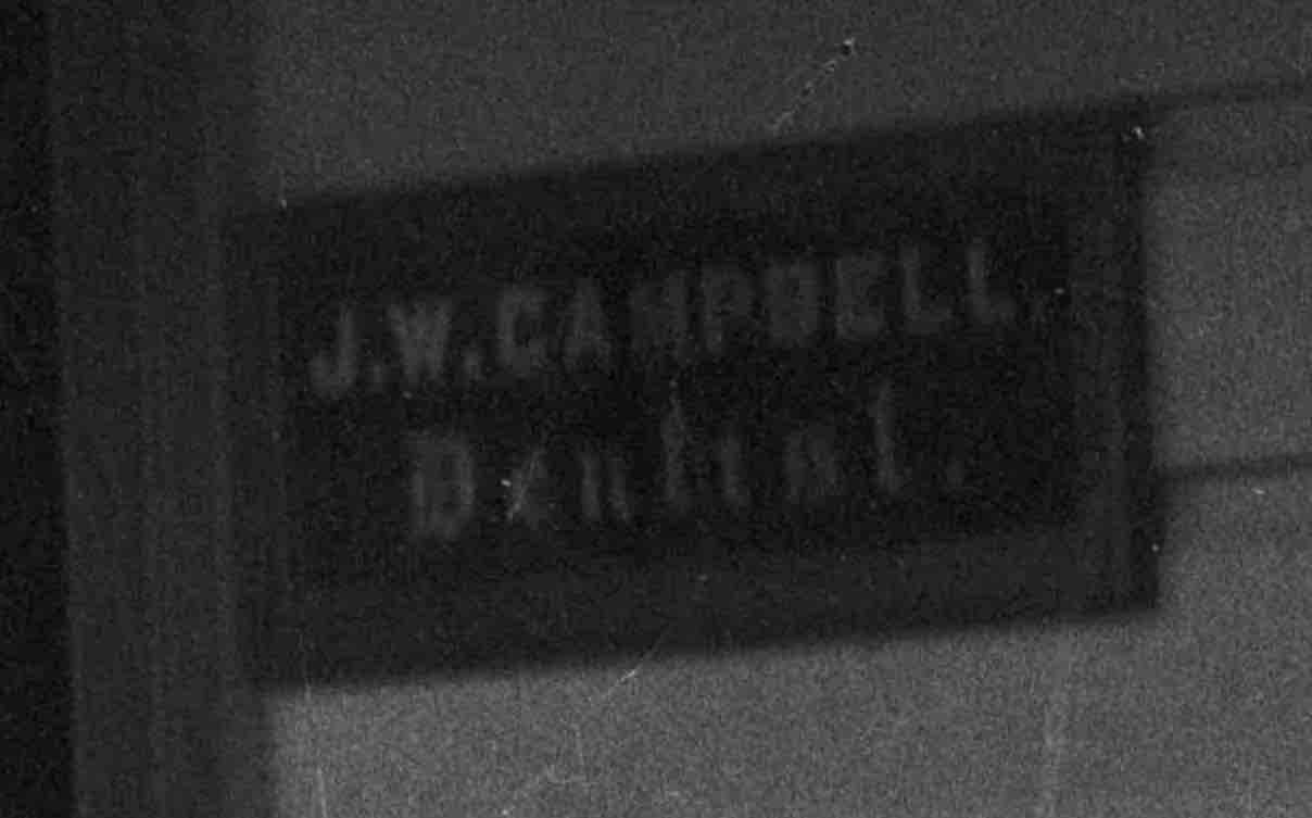 Detail of previous image. Sign next to door. Lemuel Lyes Collection.