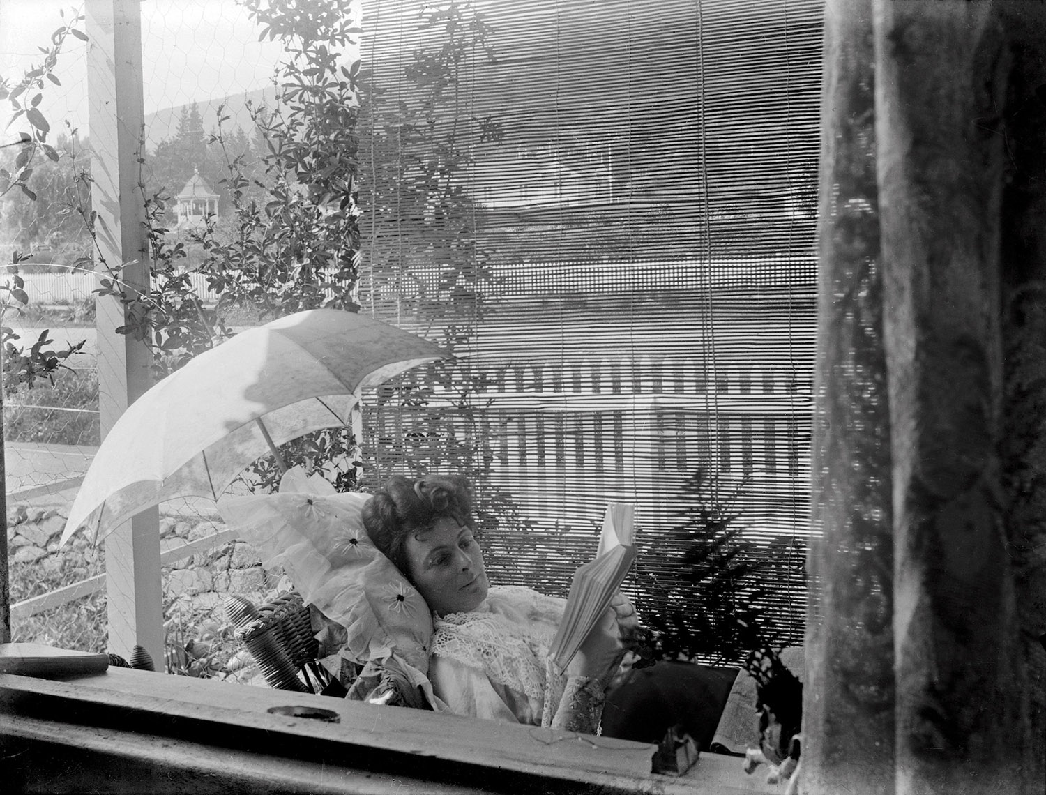 Woman relaxing with a book, Te Aroha, New Zealand, circa 1907-1911. Lemuel Lyes Collection.