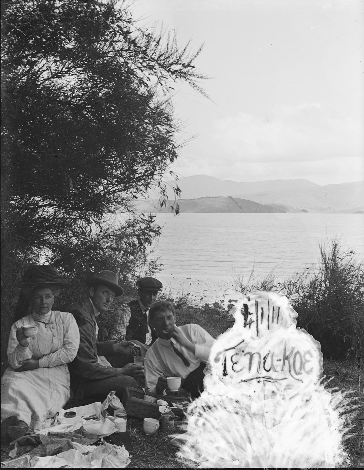 Picnic by the water, 4th January 1911. Suspect this is Lyttelton Harbour from Governor's Bay, South Island, New Zealand. Lemuel Lyes Collection.