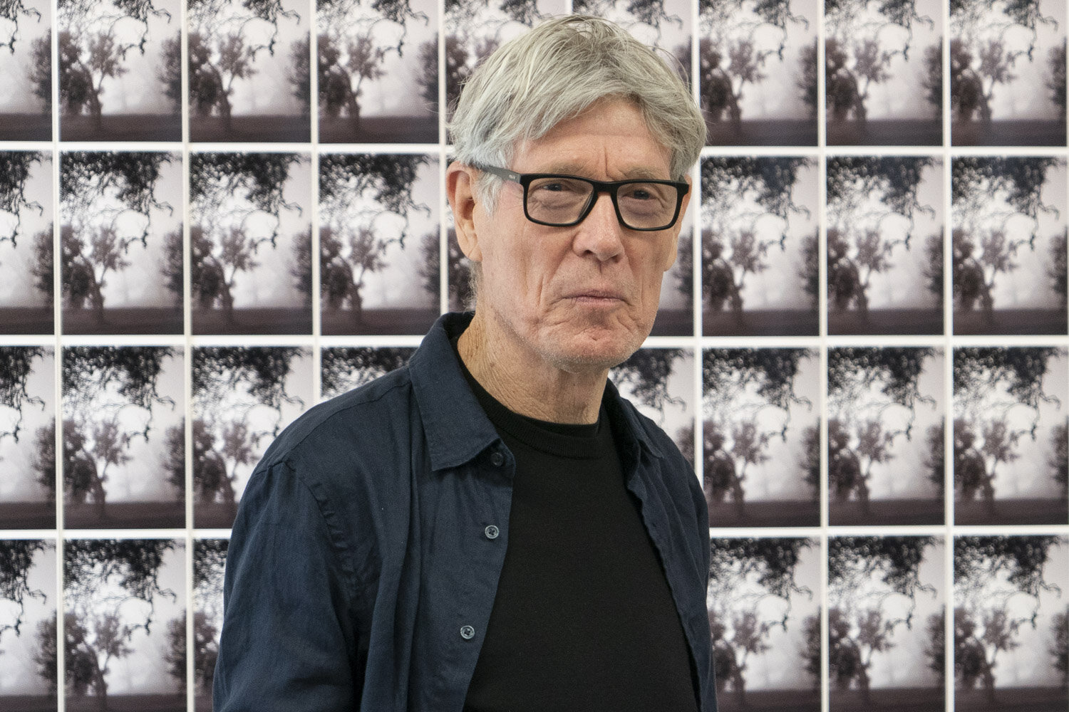 Harvey Benge at his exhibition,  Aide Memoire and other Stories , Northart, Auckland, 17 June 2018. Photo by Geoff Short