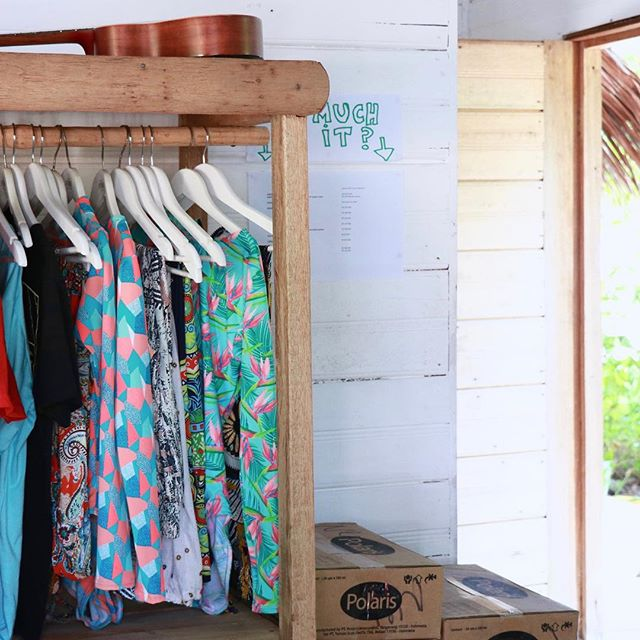 A colorful selection of island clothes, a guitar, and a door that opens out onto paradise. 🌴 cc. @biloubeachvillas