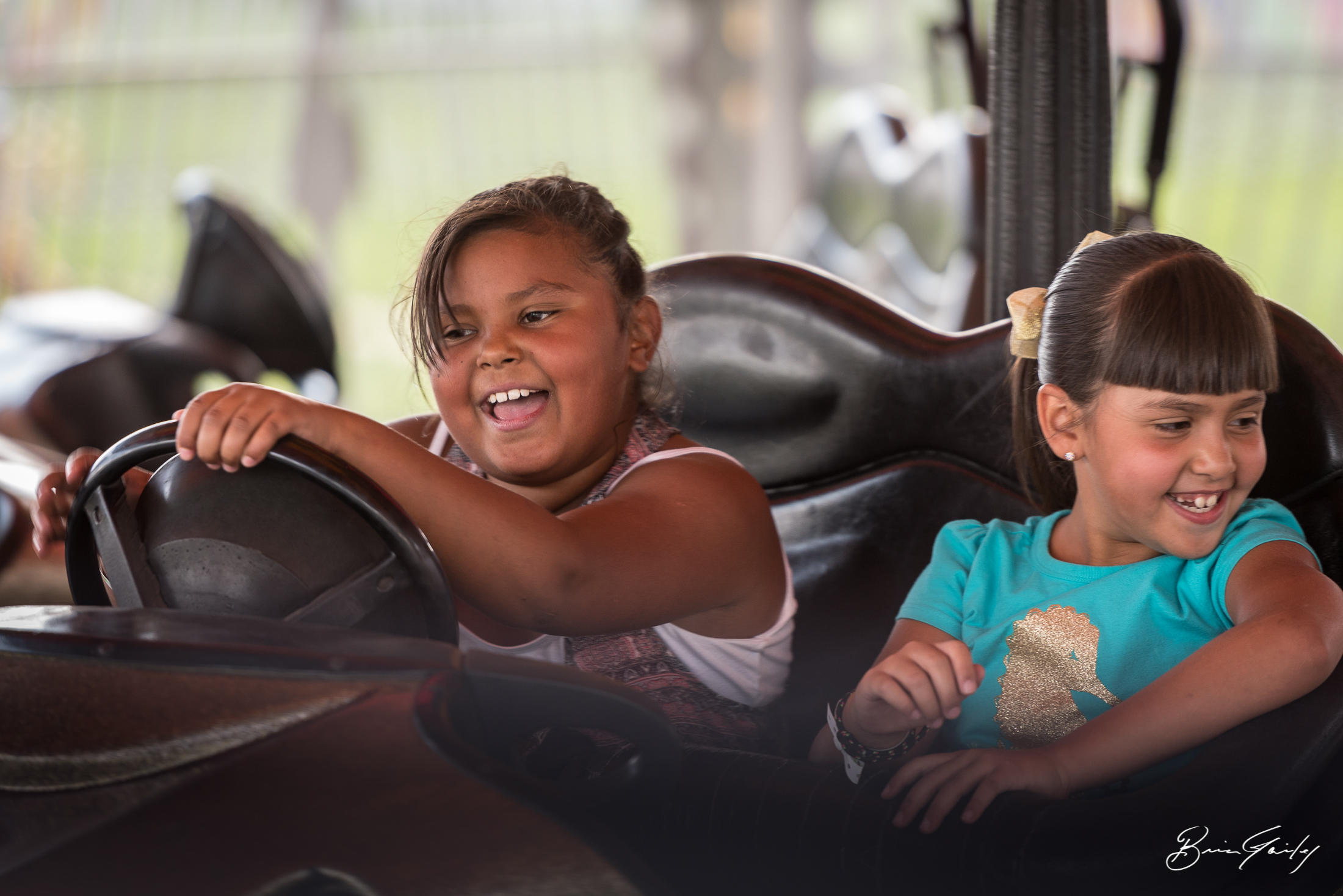 A pair of young ladies laugh while on the bumper cars.  Image:  Brian Gailey  Tulelake Butte Valley Fair 2017