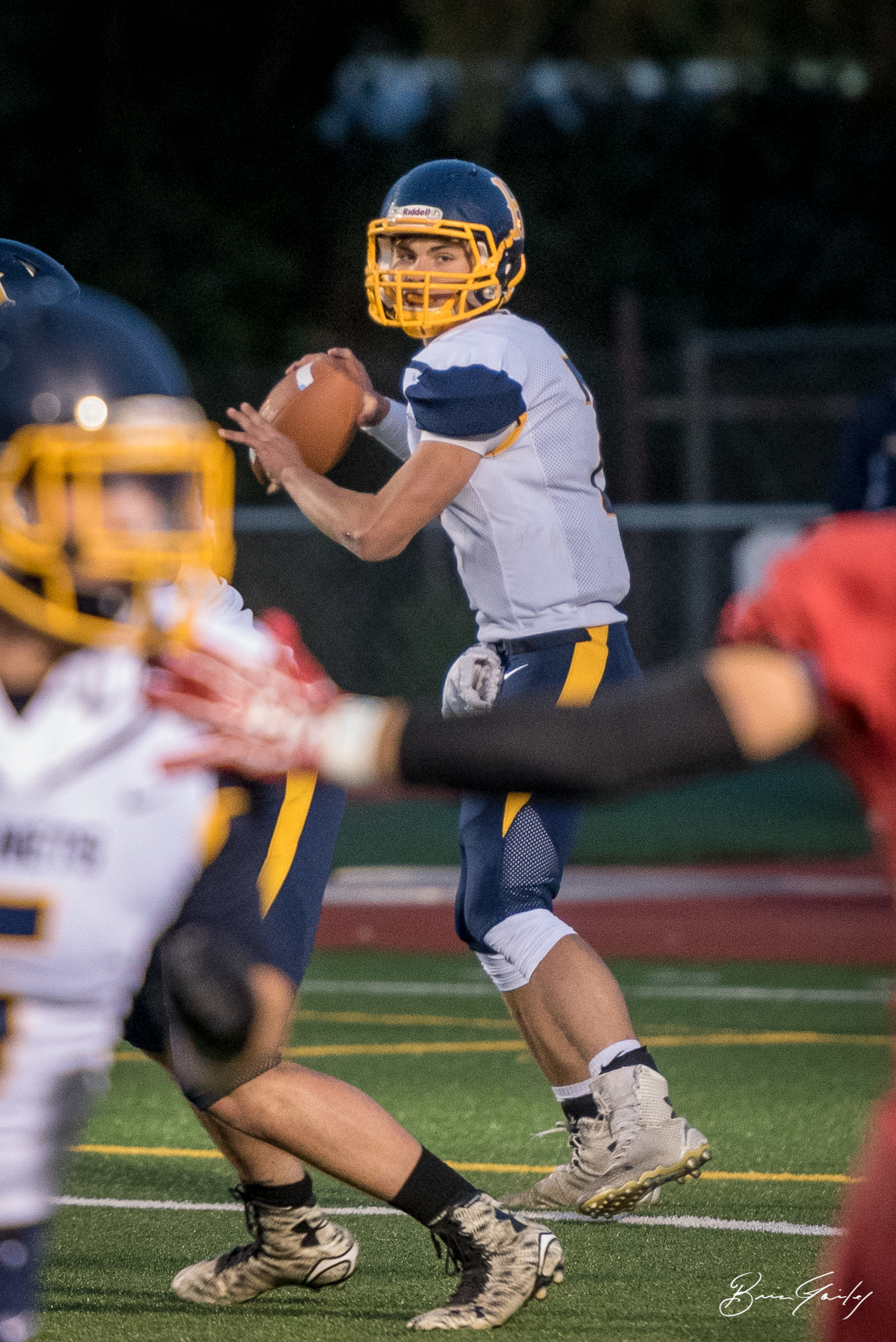 Hornet Quarterback #7, Kyle Hadwick studies the field looking for his target.