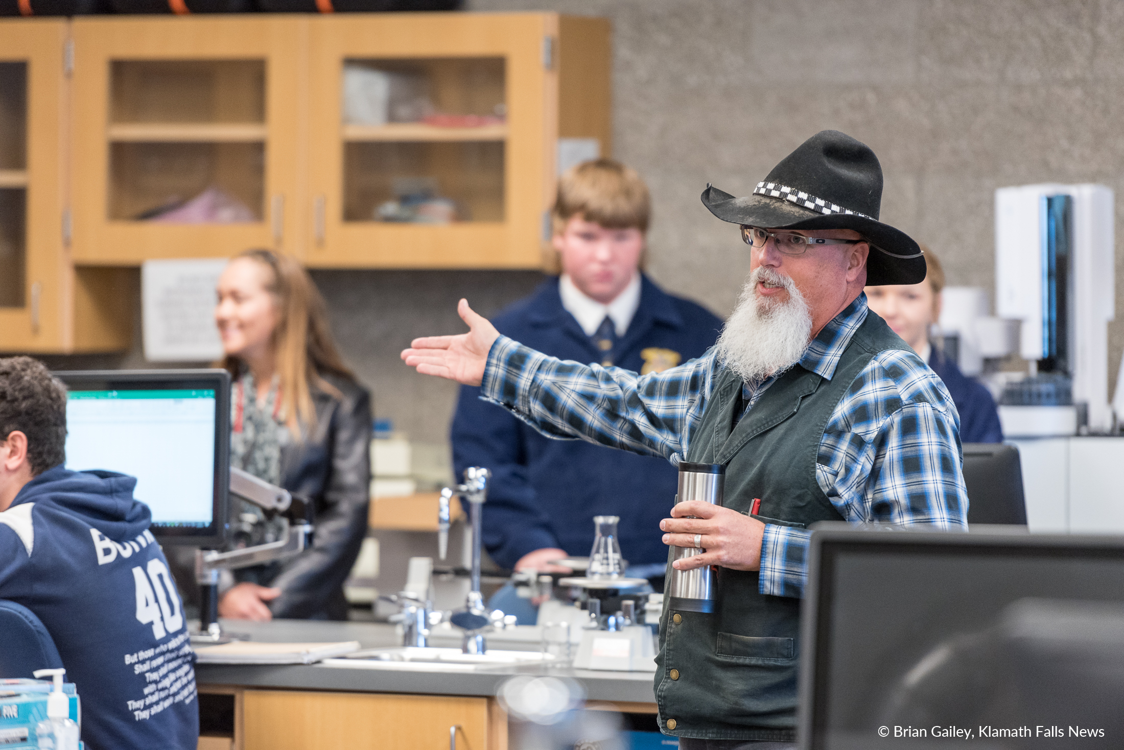 Keith Duran shows one of the KCC Science Laboratories to the Harvest Tour guests. ( Brian Gailey )