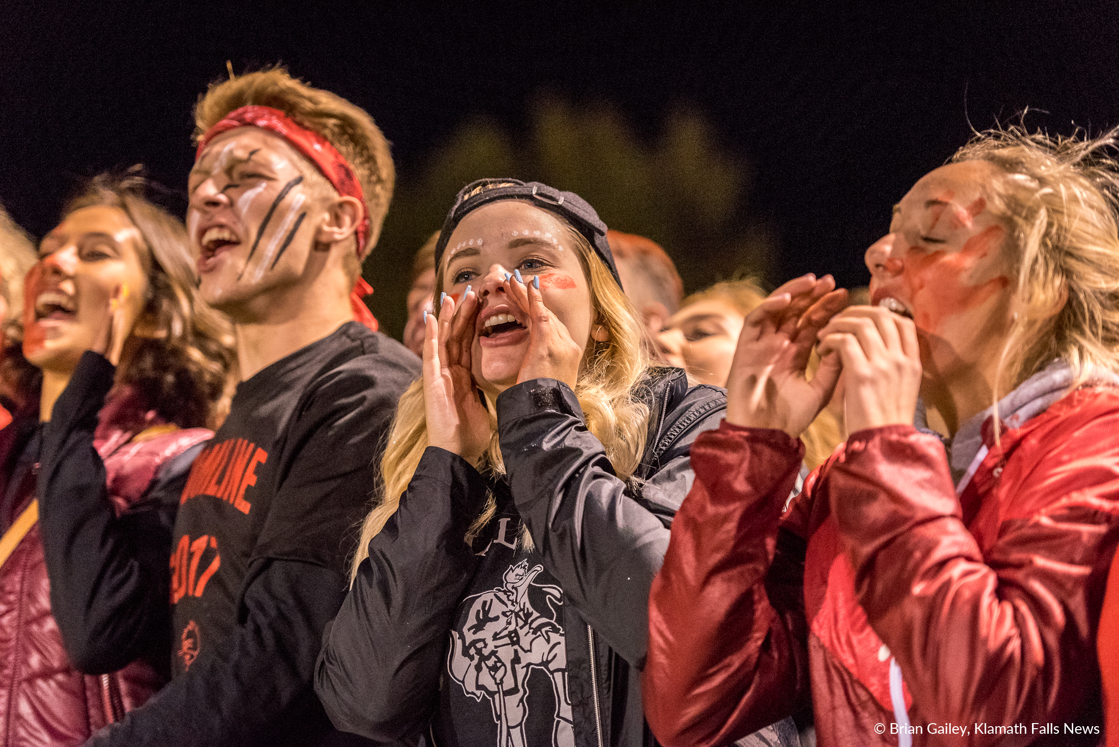 Students from Klamath Union High Schoo were loud and proud as they cheered from the visitor sidelines. ( Brian Gaile)