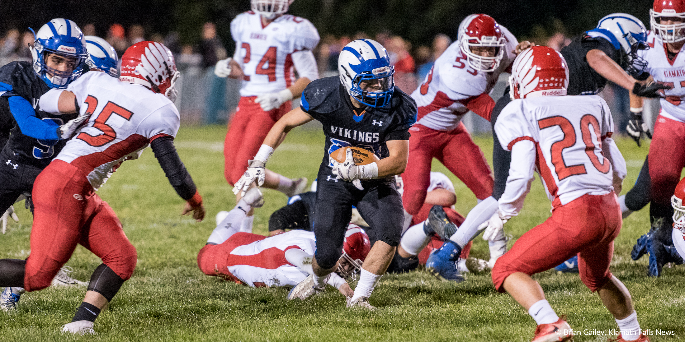 Braydon Wright scampers through the Klamath Union defense for a First Down. ( Brian Gaile)