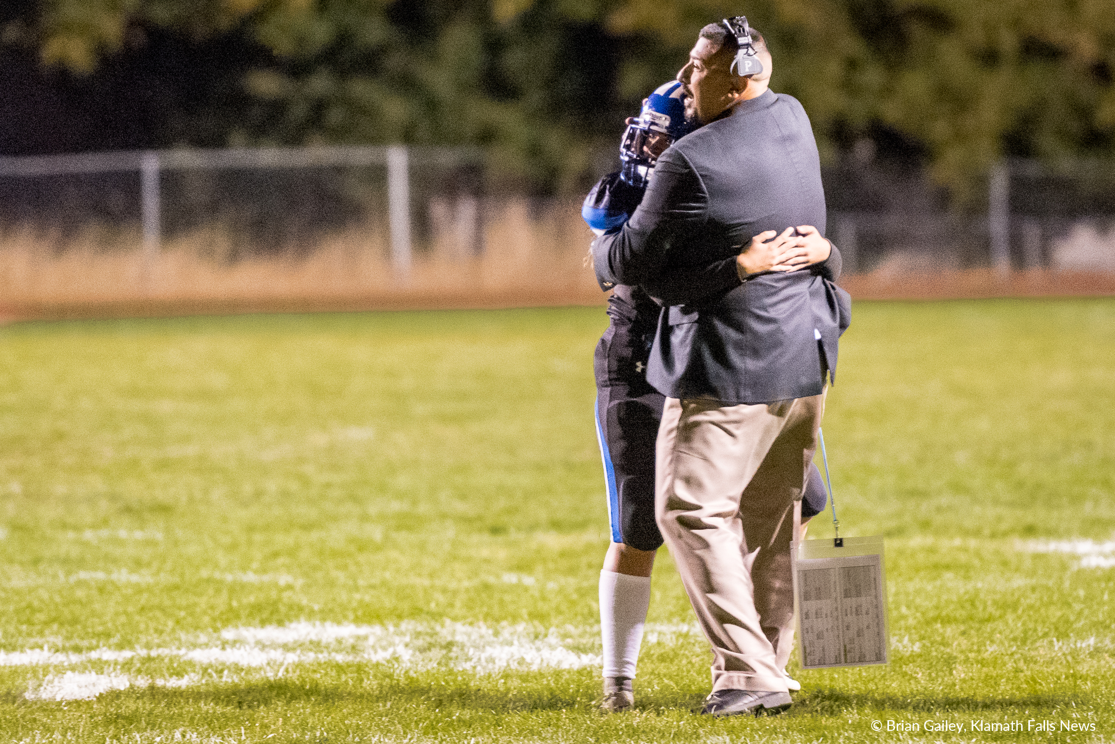 Maddy Lease celebrates with her Father and Head Coach Vic Lease after scoring her first PAT point as the new varsity kicker. ( Brian Gaile)