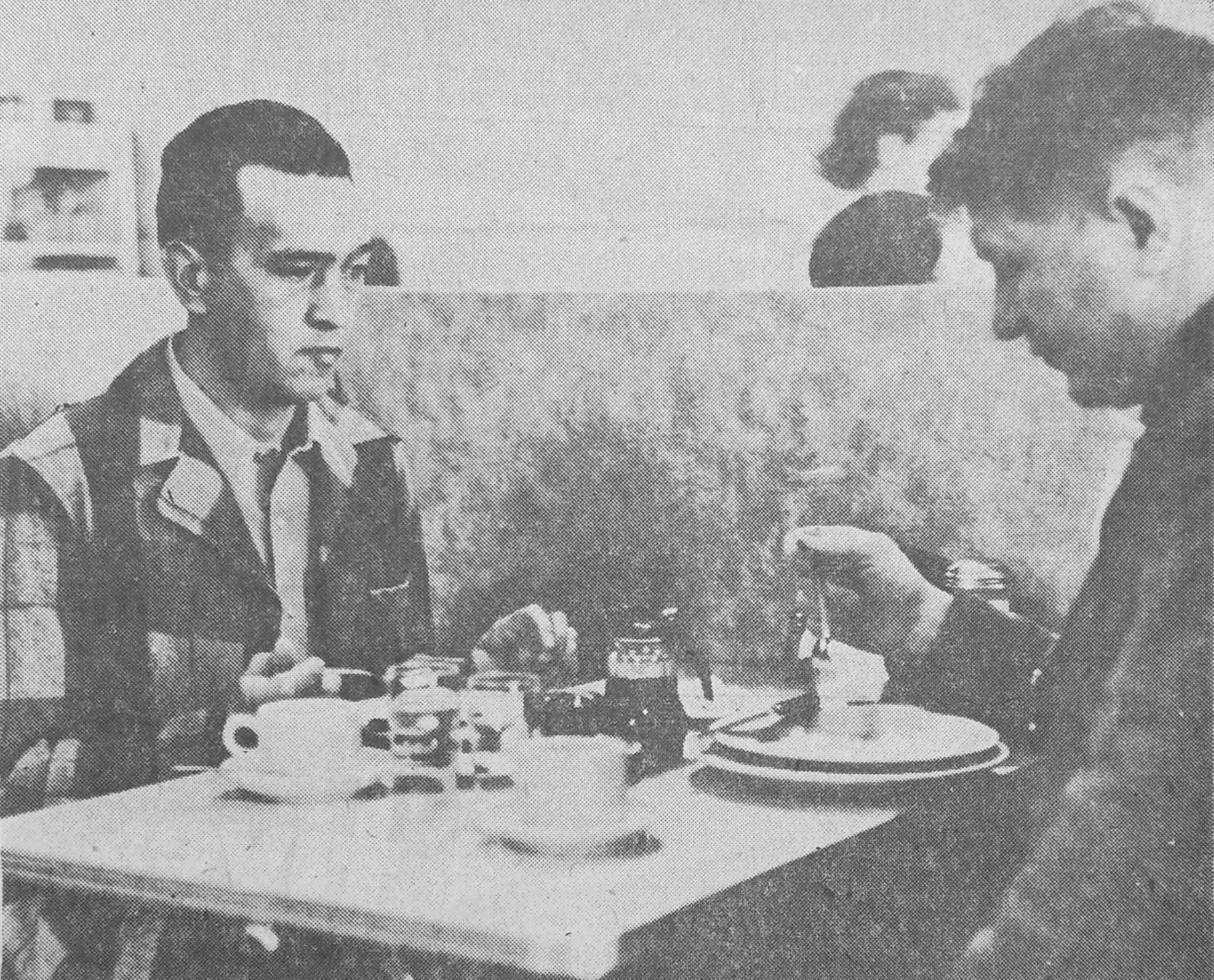 """James Q. Anderson, left, one of Klamath County's most notorious criminals in the 1950s, is seen eating breakfast with Sheriff Murray """"Red"""" Britton in this 1955 newspaper photo. (Klamath County Museum)"""