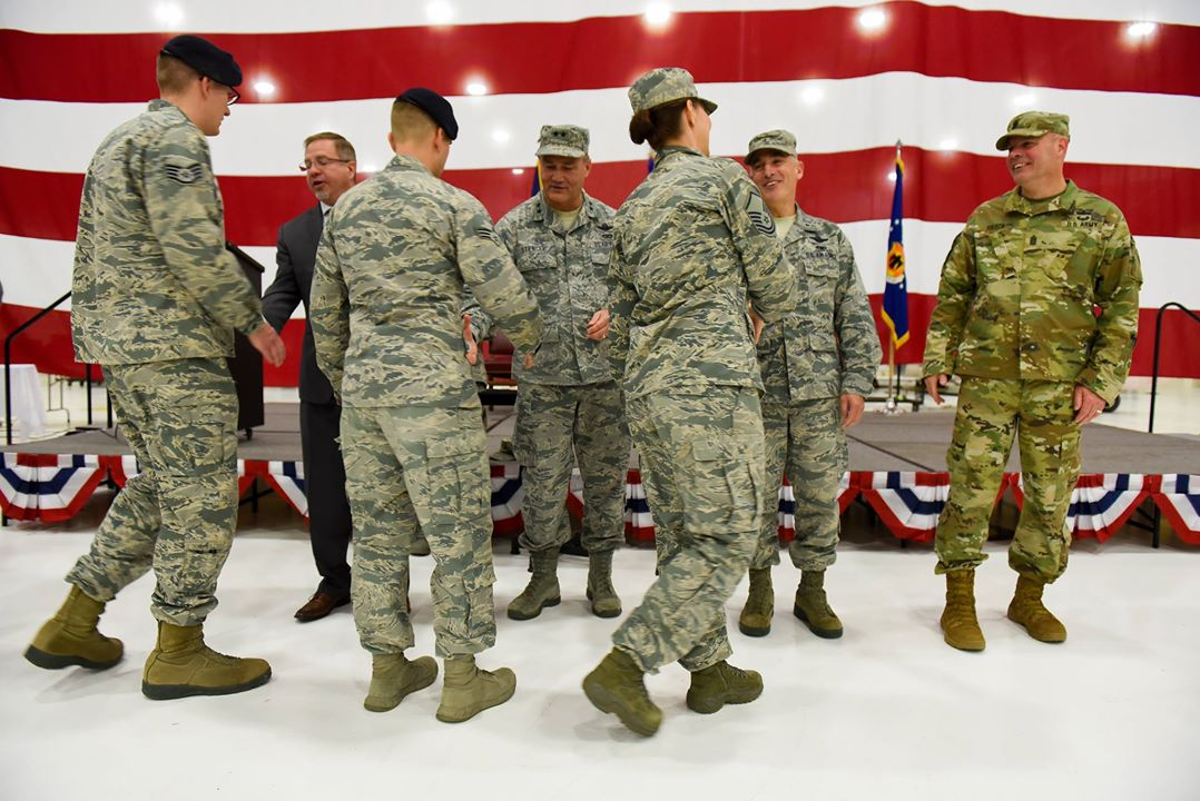 Members of the official party shake hands with Airmen from the 173rd Fighter Wing during a demobilization ceremony Nov. 4, 2017, at Kingsley Field in Klamath Falls, Ore. The ceremony formally recognized the wildland fire fighters and the 56 Kingsley Field Airmen who deployed during the wing's first ever large-scale deployment throughout 2017. (U.S. Air National Guard photo by Staff Sgt. Riley Johnson)