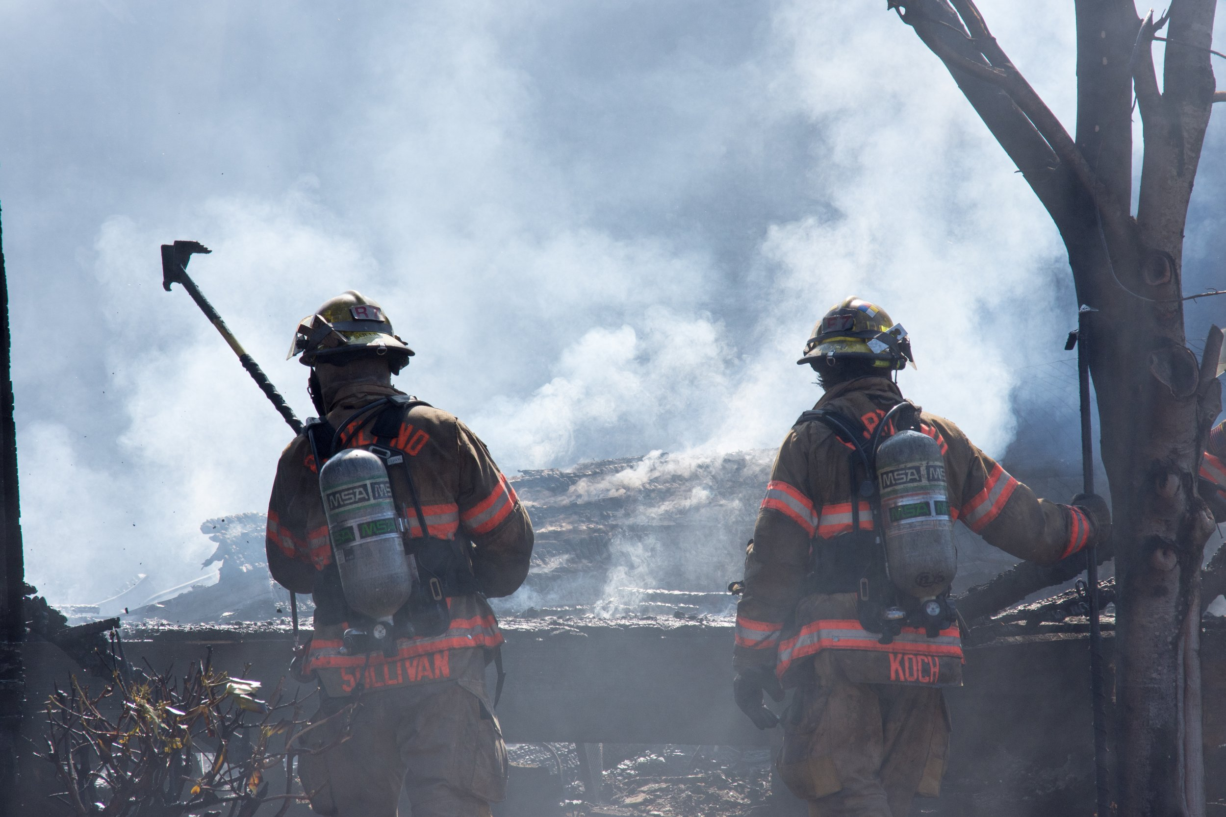 Firefighters monitor hot spots in a blaze. (File Photo, Benjamin Kerensa)