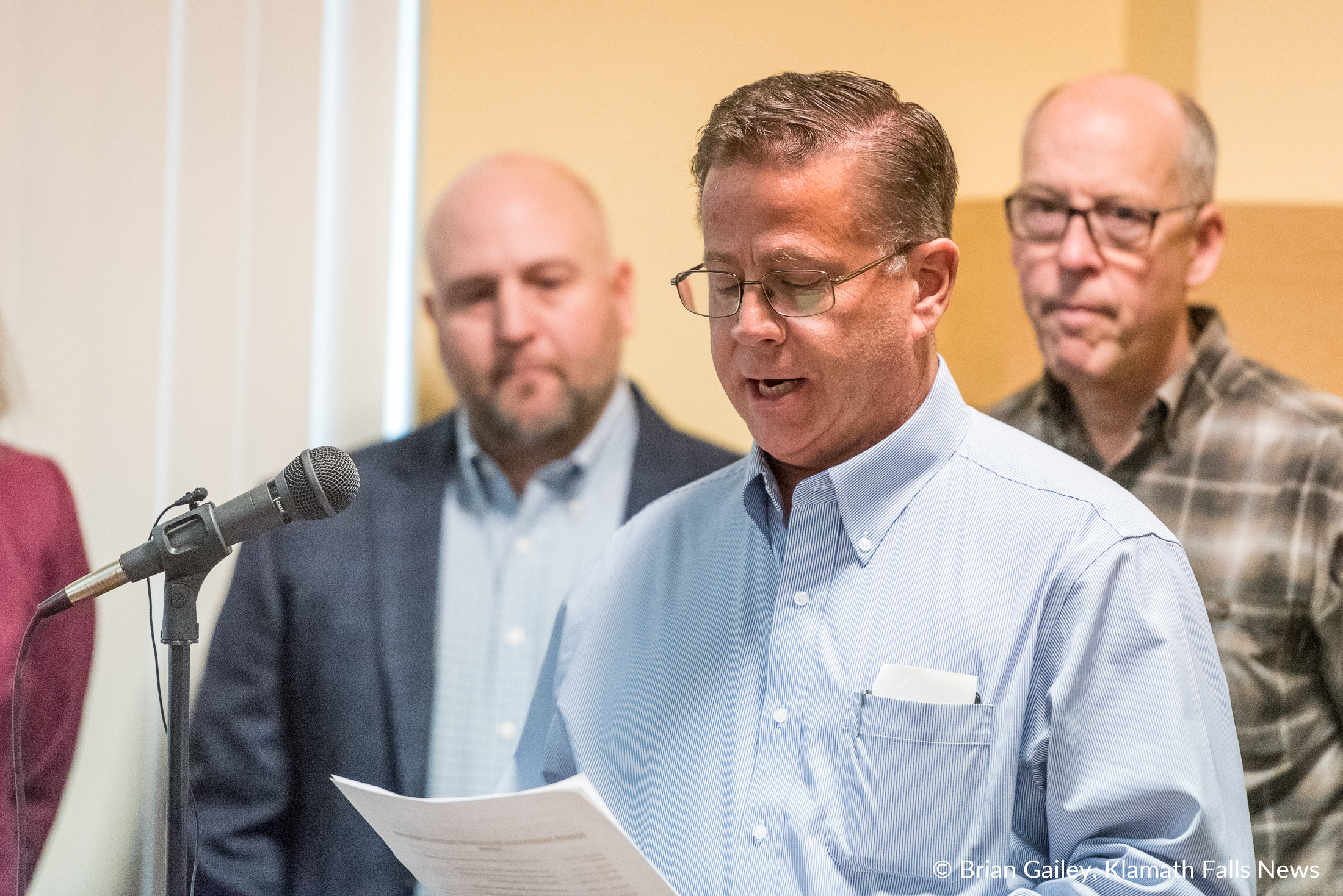 Commissioner Donnie Boyd reads a statement on behalf of the Klamath County Commissioners. During a press conference when Congressman Walden Announces Klamath Infrastructure Improvement Act to a standing room only crowd at the Klamath County Chamber of Commerce. (Brian Gailey)