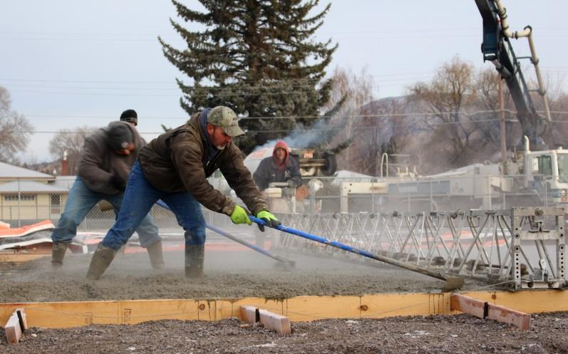 Construction workers spread poured concrete forming the foundation of new classrooms at Peterson Elementary School (Samantha Tipler, KCSD)