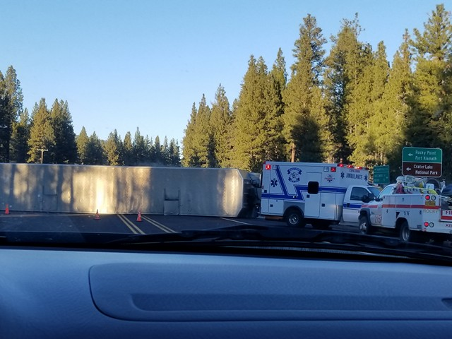 Overturned cattle truck near West Side Road and Highway 140 at Rocky Point. Image by Ching Lange.