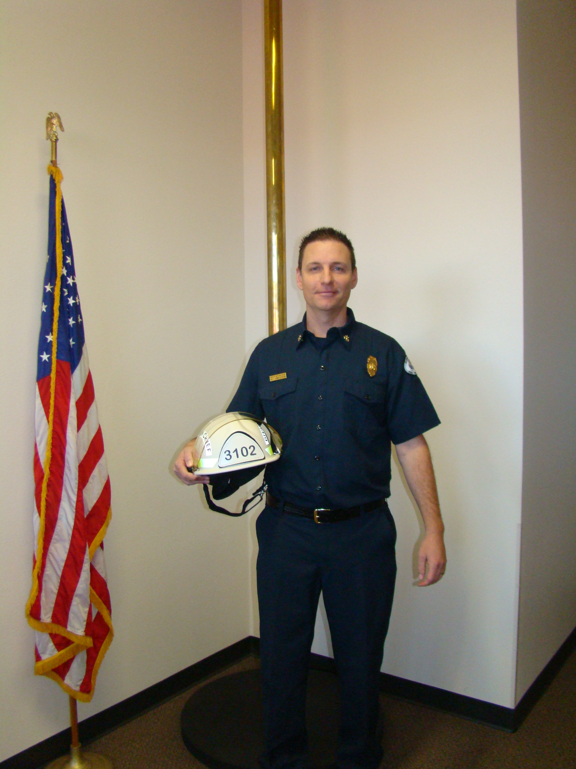 Hitchcock poses as the new Division Chief. (Image, KCFD 1)
