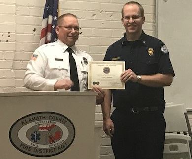 Deputy State Fire Marshal, Craig Rice (Left) presented KCFD1's Fire Marshal, Craig Andresen (Right) with the State's highest level of recognition as Fire Marshal at KCFD1's Board of Director meeting on Tuesday, January 16.