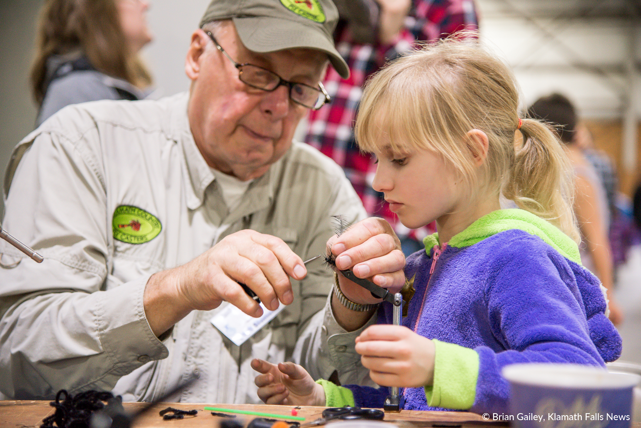 Lily Tompkins and Dick Siemens with the Klamath County Flycasters. Create a unique and beautiful fishing fly at PLAY Outdoors, Klamath Falls, Ore. - January 20, 2018 (Brian Gailey)