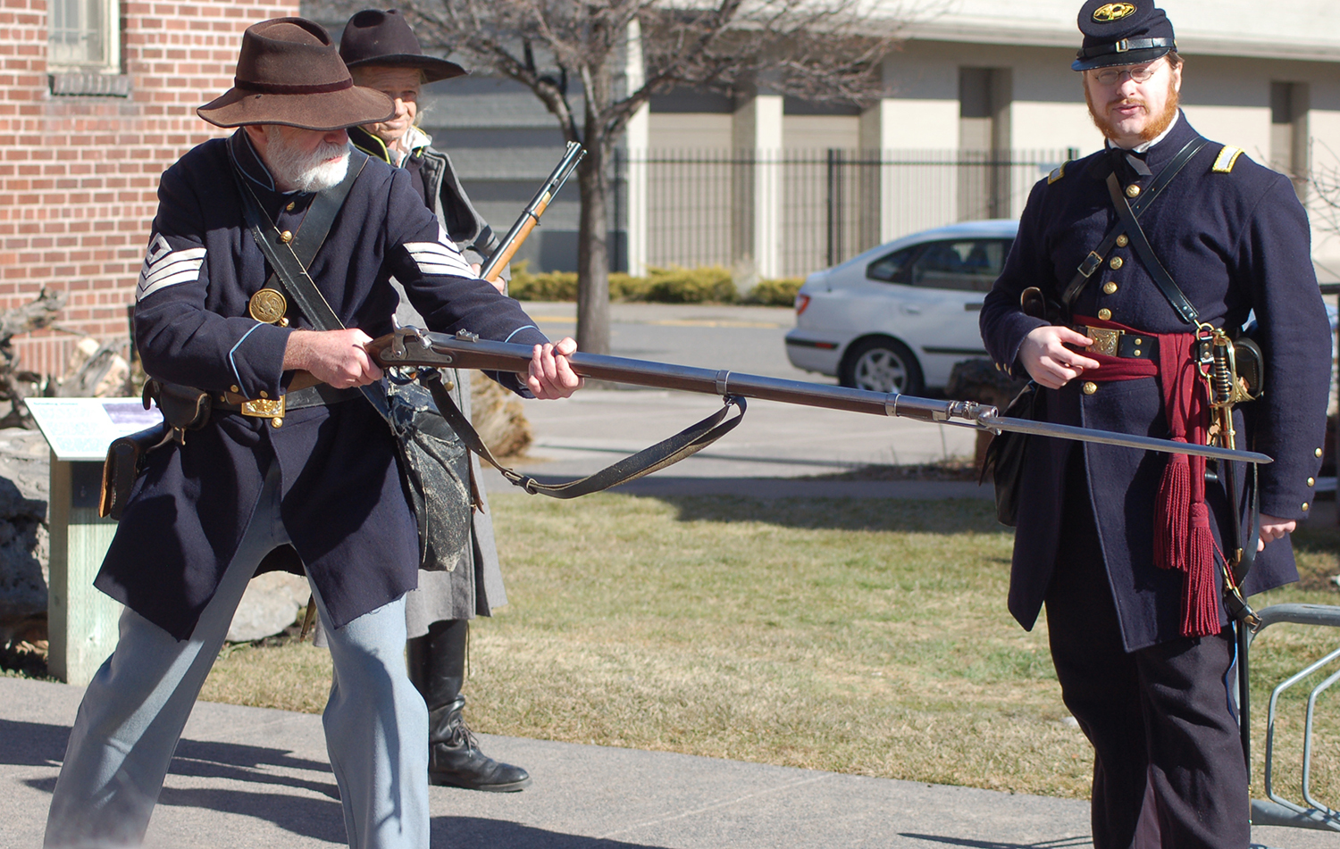 Marv Collision, left, demonstrates use of a Civil-war era bayonet during 1860s Days at the Klamath County Museum in February 2017. Members of the Cascade Civil War Society will return to the museum for this year's event Saturday, Feb. 10. At right is Civil War re-enactor Clark Morningstar. (Klamath County Museum)
