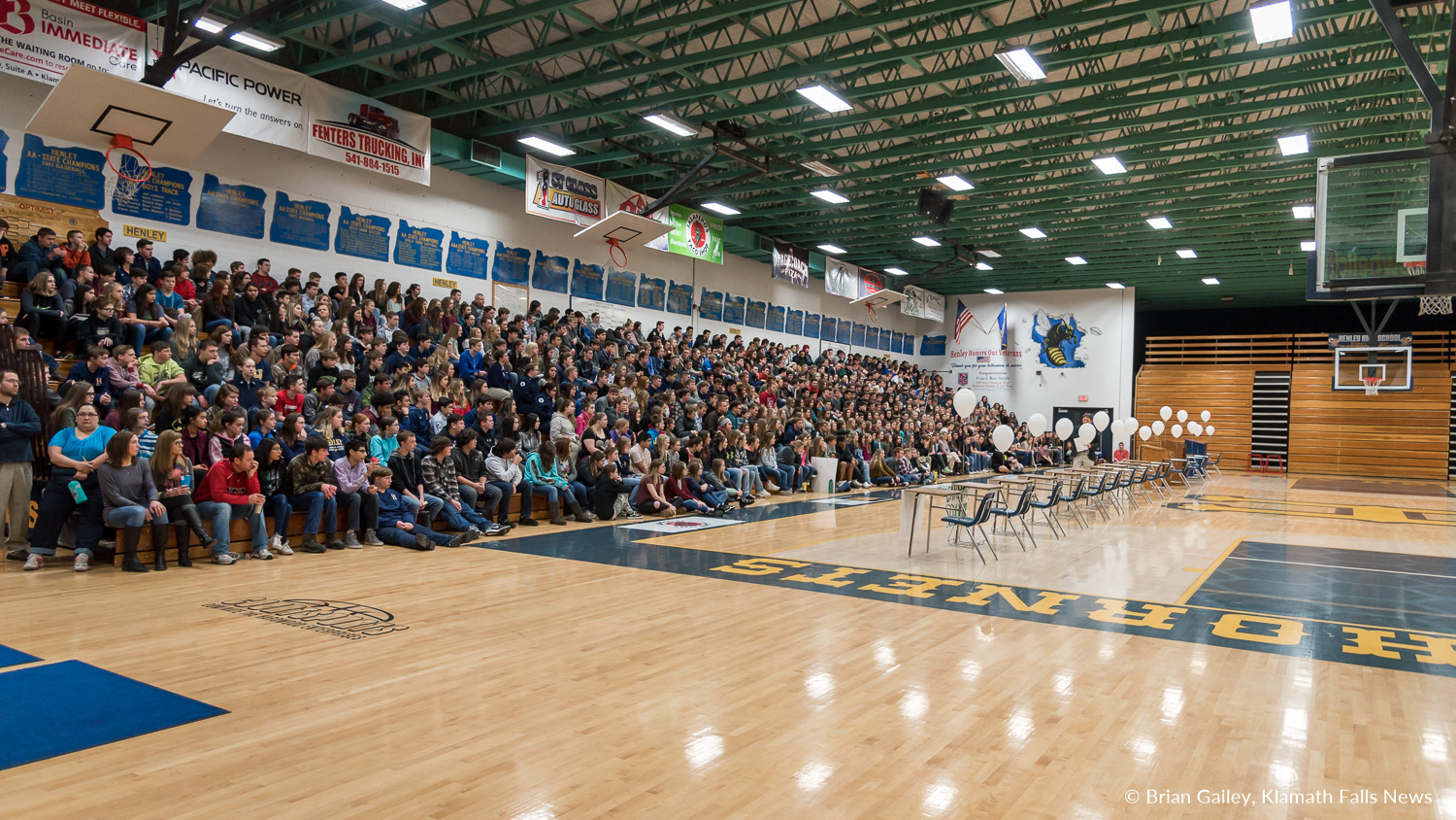 HHS Principal Jack Lee, addresses the school about Parkland.  Henley High School student led assembly to walk up in support for Marjorie Stoneman DouglasHigh School rather than walking out in protest of Gun Control honored the 17 lives lost at the Parkland Shooting. March 14, 2018. (Brian Gailey)