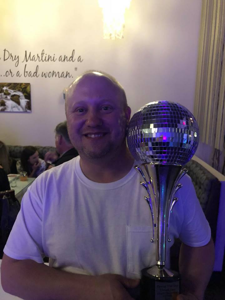 """Tony """"AJ"""" Halda, holds the Mirror Ball Trophy as the 2018 Winner of Dancing With Your Stars (Ross Ragland Theater, Facebook)."""