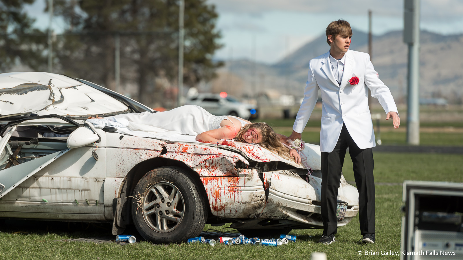 Operation Prom Night, a staged DUII car crash to teach teens the reality of drinking and driving. Kyle Hadwick and Kaila Mick are seen participating in the simulation April 19, 2018 (Brian Gailey)