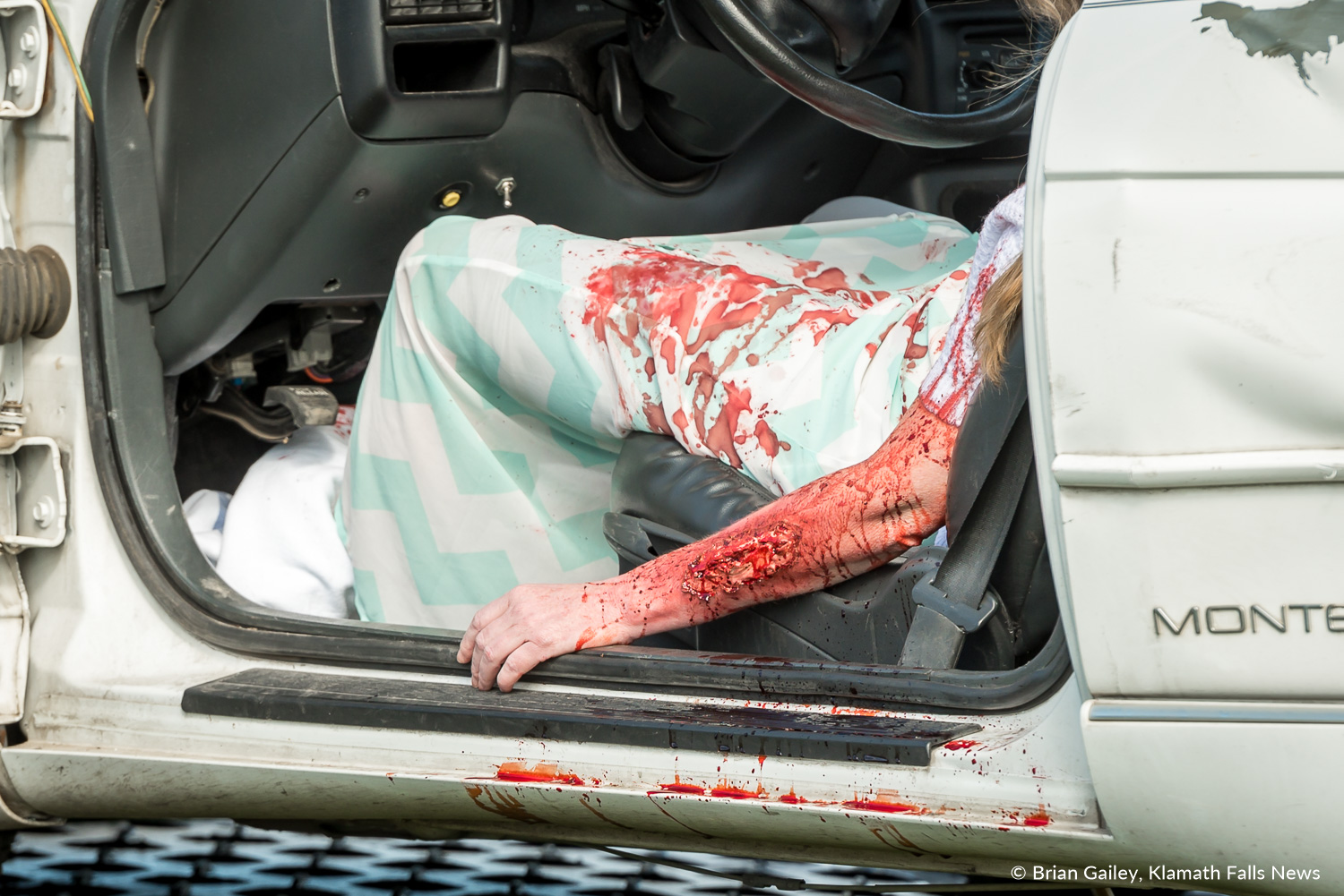 Operation Prom Night, a staged DUII car crash to teach teens the reality of drinking and driving. The arm of Marja Hill is seen in the simulation April 19, 2018 (Brian Gailey)