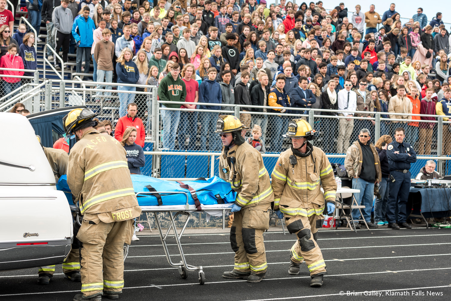 Operation Prom Night, a staged DUII car crash to teach teens the reality of drinking and driving. Kaila Mick, in the body bag, is loaded into the back of a hearse. First responders from KCSD1 are seen participating in the simulation as students look on. April 19, 2018 (Brian Gailey)