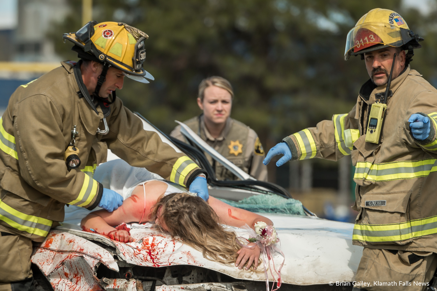Operation Prom Night, a staged DUII car crash to teach teens the reality of drinking and driving. Kaila Mick and members of KCFD1 and Deputy Petersen of the KCSO are seen participating in the simulation April 19, 2018 (Brian Gailey)