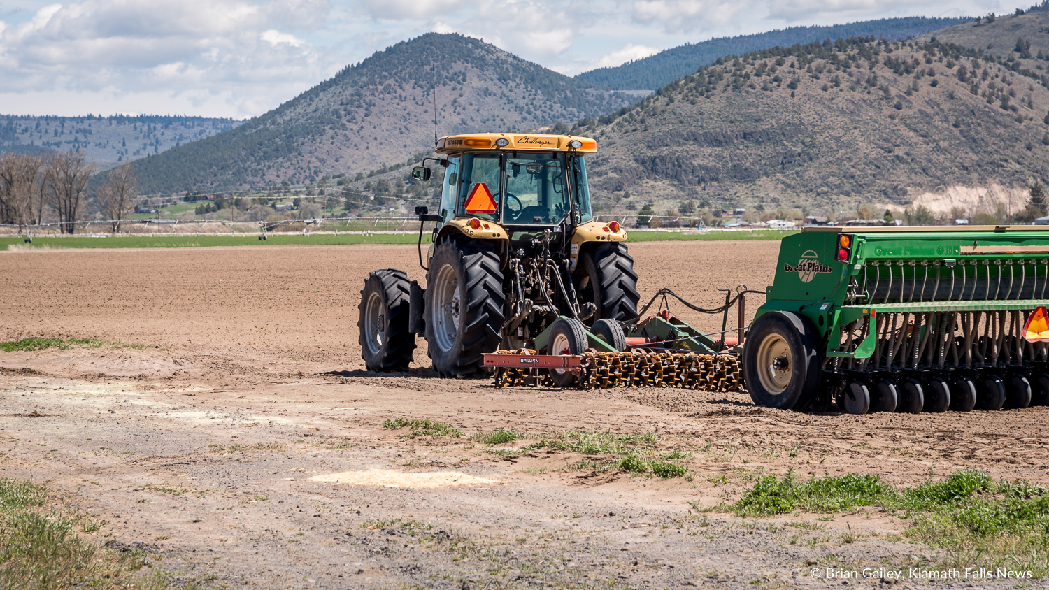 File Photo:A taractor sits idle in a dry field, Klamath County, Ore. (Brian Gailey)