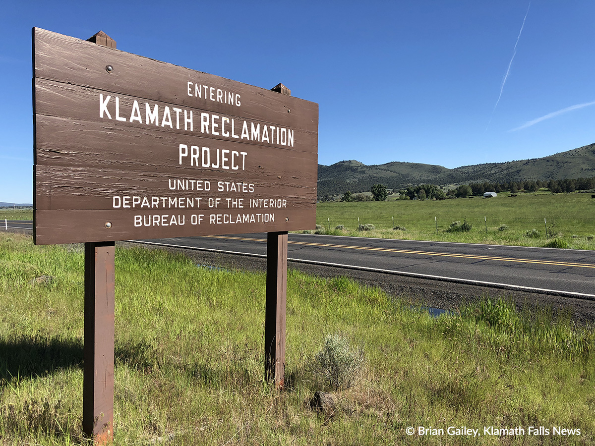 File Photo. Painted wooden sign marking the Klamath Project near Poe Valley, Ore. (Brian Gailey)
